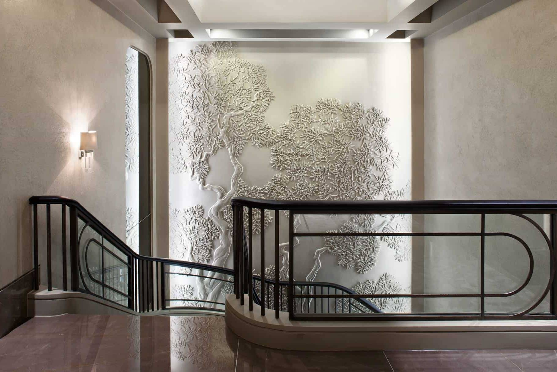 Olive tree bas-relief in residential stairwell area